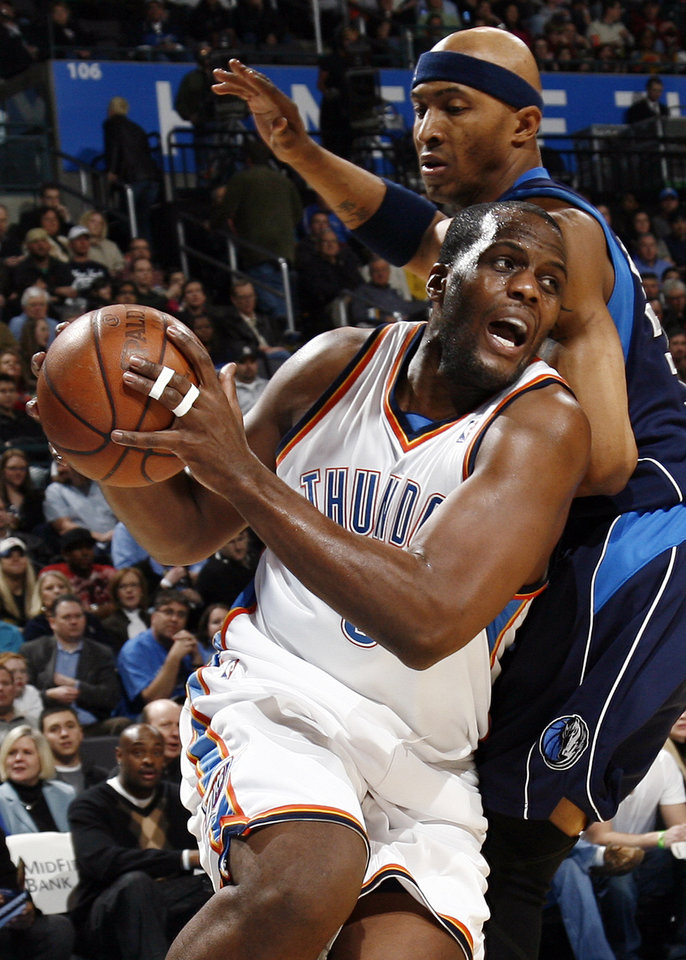Oklahoma City's Malik Rose (9) moves around James Singleton (33) of Dallas in the first half during the NBA basketball game between the Dallas Mavericks and the Oklahoma City Thunder at the Ford Center in Oklahoma City, March 2, 2009. BY NATE BILLINGS, THE OKLAHOMAN