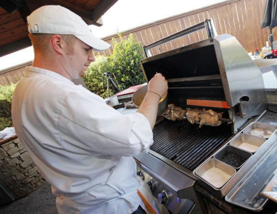 Chef Luke Fry prepares honey and whiskey shellacked Cornish game hens at American Propane, 7401 Broadway Extension. Photo by Nate Billings, The Oklahoman <strong>NATE BILLINGS</strong>