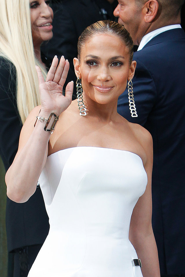 Photo - Singer Jennifer Lopez waves as she arrives for the Atelier Versace Fall Winter 2014-15  Haute Couture fashion collection, presented in Paris, Sunday, July 6, 2014. (AP Photo/Thibault Camus)