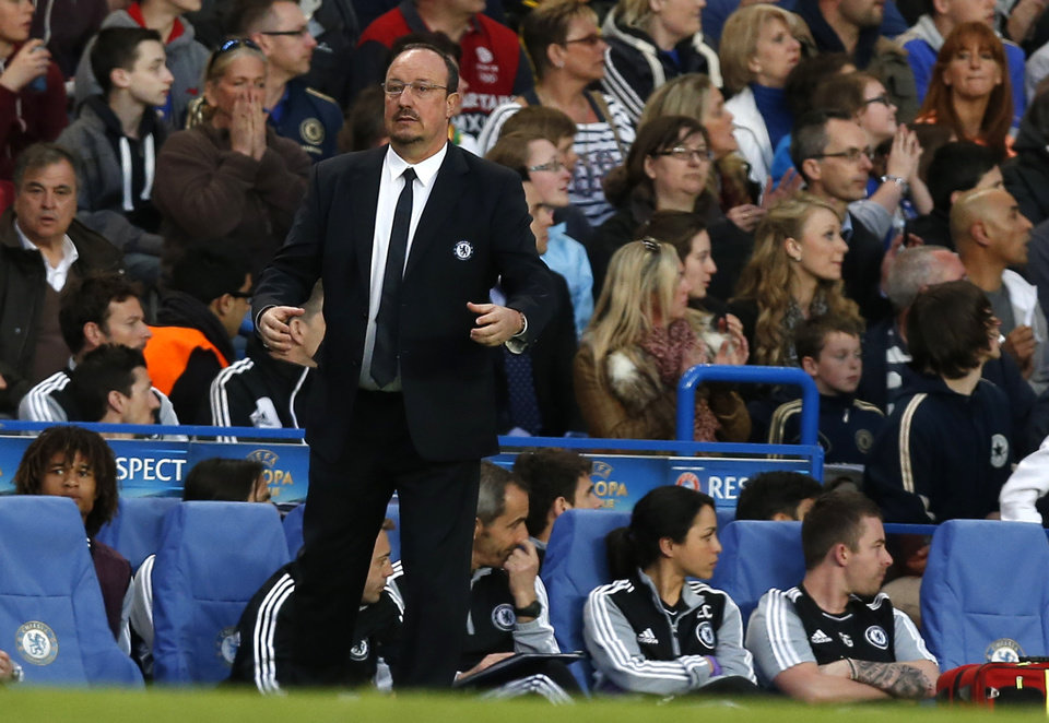 Chelsea's interim first team manager Rafael Benitez watches his team play Basel during their Europa League semifinal second leg soccer match, at Chelsea's Stamford Bridge stadium in London, Thursday, May  2, 2013. (AP Photo/Sang Tan)
