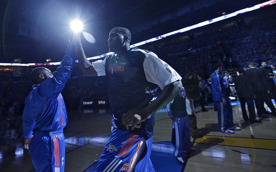 Photo - Oklahoma City's Kendrick Perkins makes his way onto the court in team introductions during game one of the Western Conference semifinals between the Memphis Grizzlies and the Oklahoma City Thunder in the NBA basketball playoffs at Oklahoma City Arena in Oklahoma City, Sunday, May 1, 2011. Photo by Chris Landsberger, The Oklahoman