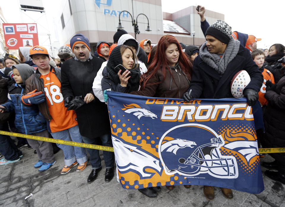 Photo - Denver Broncos fans wait for the players to arrive at the team hotel Sunday, Jan. 26, 2014, in Jersey City, N.J. The Broncos are scheduled to play the Seattle Seahawks in the NFL Super Bowl XLVIII football game Sunday, Feb. 2, in East Rutherford, N.J. (AP Photo/Mark Humphrey)