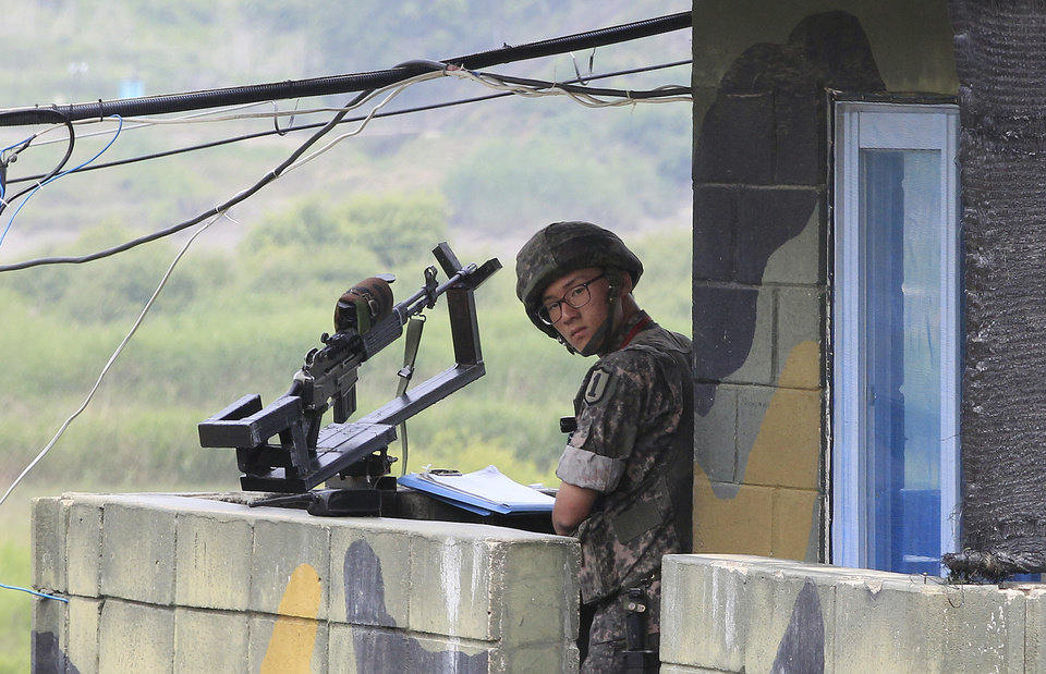 Photo - A South Korean army soldier stands guard at a military checkpoint near the border village of Panmunjom, which has separated the two Koreas since the Korean War, in Paju, South Korea, Saturday, June 7, 2014. North Korea has detained a 56-year old man from Ohio, accusing him of an unspecified crime after he traveled to the communist-led country as a tourist, the nation's state news agency and the man's family said Friday. (AP Photo/Ahn Young-joon)