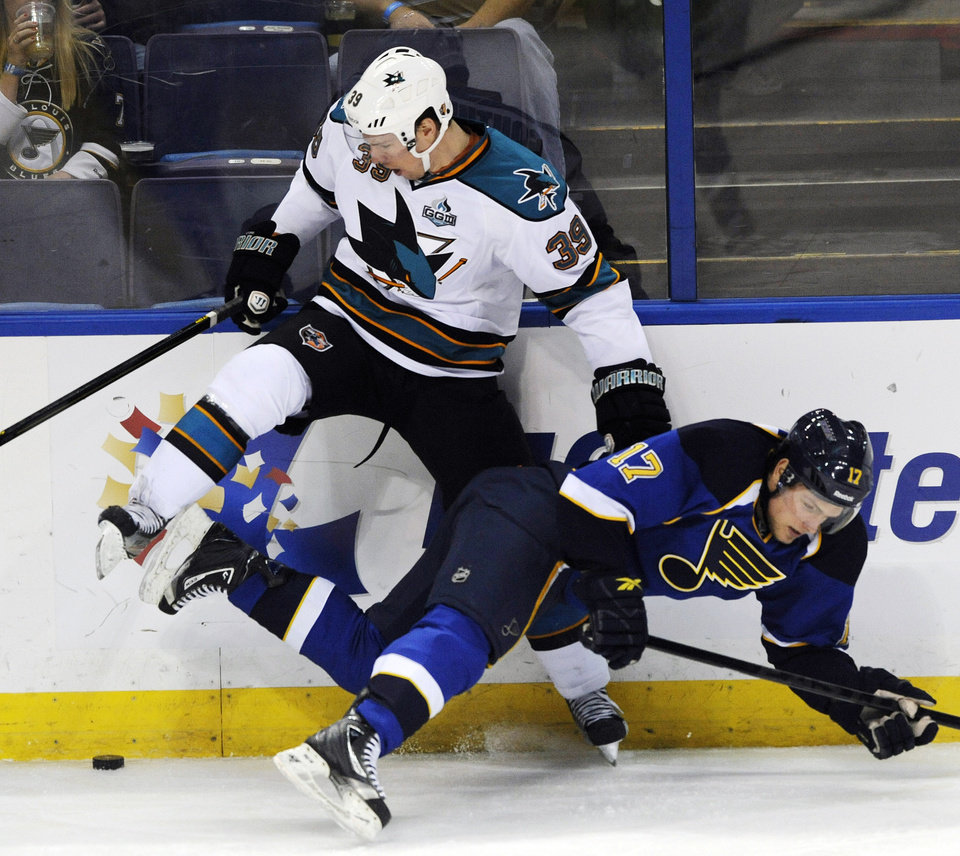 San Jose Sharks' Logan Couture (39) collides with St. Louis Blues' Vladimir Sobotka (17), of the Czech Republic, in the second period of an NHL hockey game, Tuesday, Feb. 19, 2013, in St. Louis. (AP Photo/Bill Boyce)