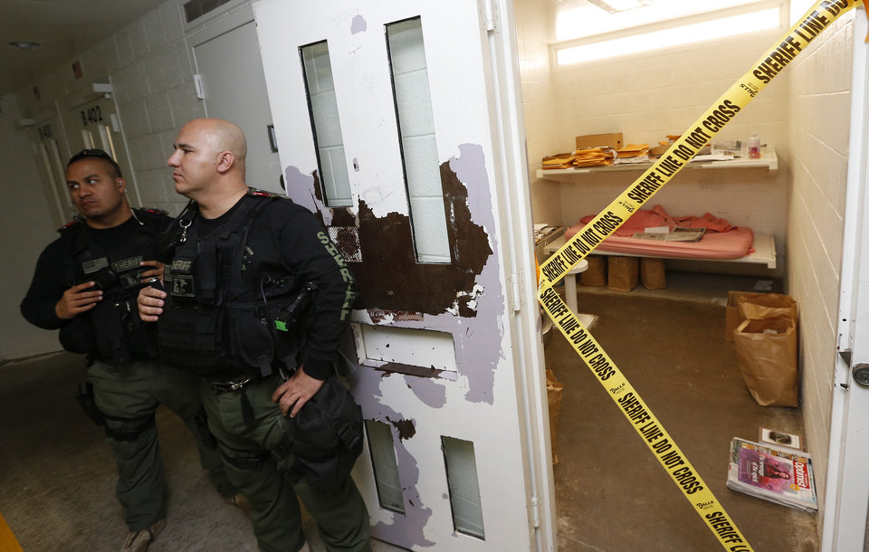 Photo - Maricopa County Sheriffs Deputies stand guard in front of the cell of convicted killer Jodi Arias at the Maricopa County Sheriffs Office Estrella Jail, on Thursday, May 16, 2013, in Phoenix. Arias was convicted of first-degree murder in the gruesome killing of her one-time boyfriend, Travis Alexander, in their suburban Phoenix home. (AP Photo/Ross D. Franklin)
