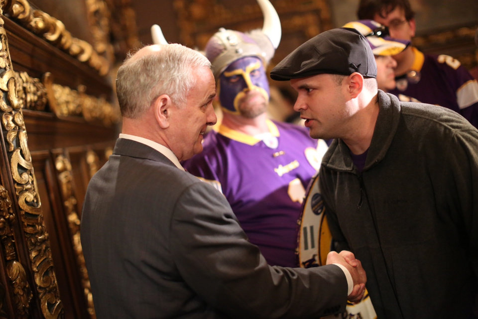Photo -   A Vikings fan thanked Gov. Mark Dayton, left, after the stadium bill passed in the House Monday night, May 7, 2012 at the Capitol in St. Paul, Minn. The Minnesota House has approved a plan to build a $975 million stadium for the Vikings, but with a big boost in what the team would pay. (AP Photo/The Star Tribune,Renee Jones Schneider ) MANDATORY CREDIT; ST. PAUL PIONEER PRESS OUT; MAGS OUT; TWIN CITIES TV OUT