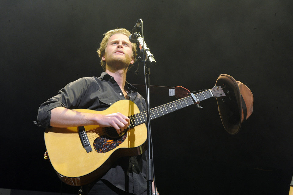 FILE - In this Dec. 8, 2012 file photo, Wesley Schultz of The Lumineers performs at KROQ Almost Acoustic Christmas in Los Angeles. The Lumineers' �Ho Hey� was the top streamed track on Spotify for the week of Dec. 10. (Photo by Katy Winn/Invision/AP, File)