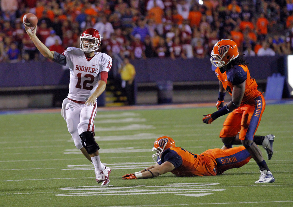 Photo - Oklahoma Sooners quarterback Landry Jones (12) tries to get away from the pressure of the UTEP defense during the college football game between the University of Oklahoma Sooners (OU) and the University of Texas El Paso Miners (UTEP) at Sun Bowl Stadium on Saturday, Sept. 1, 2012, in El Paso, Texas.  Photo by Chris Landsberger, The Oklahoman