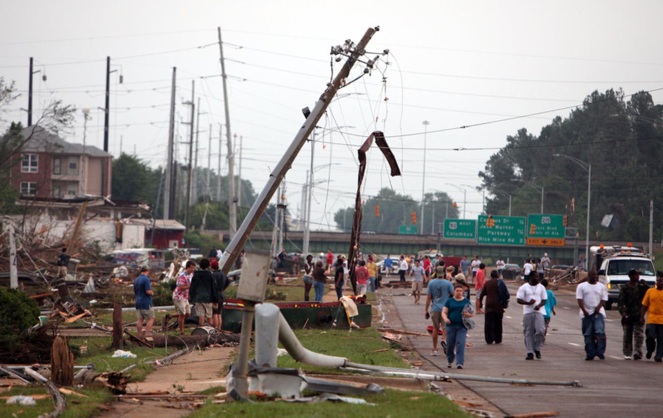 Photo - Homes and businesses along McFarland Blvd. are completely destroyed in Tuscaloosa, Ala. Wednesday, April 27, 2011. A wave of severe storms laced with tornadoes strafed the South on Wednesday, killing at least 16 people around the region and splintering buildings across swaths of an Alabama university town. (AP Photo/The Tuscaloosa News, Dusty Compton)