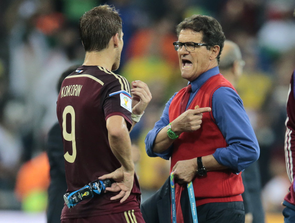Photo - Russia's head coach Fabio Capello gestures as he talks to Russia's Alexander Kokorin after the group H World Cup soccer match between Algeria and Russia at the Arena da Baixada in Curitiba, Brazil, Thursday, June 26, 2014. (AP Photo/Ivan Sekretarev)