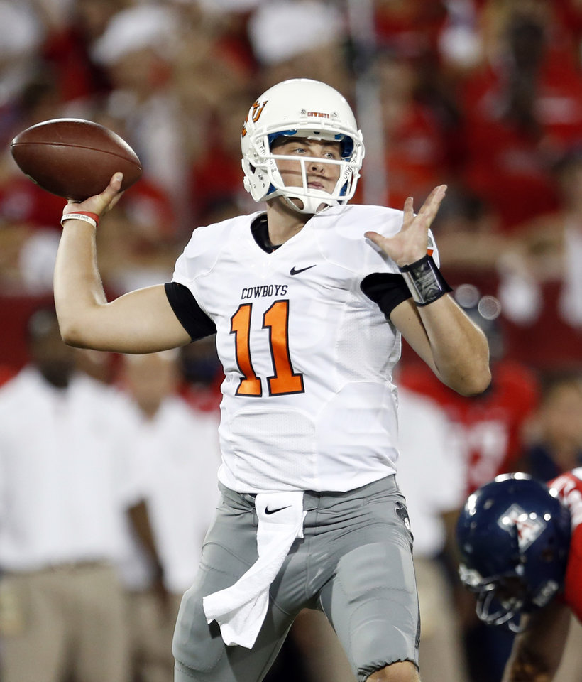 Oklahoma State\'s Wes Lunt (11) throws during the college football game between the University of Arizona and Oklahoma State University at Arizona Stadium in Tucson, Ariz., Saturday, Sept. 8, 2012. Photo by Sarah Phipps, The Oklahoman