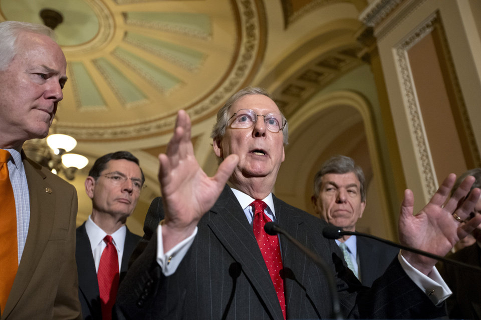 Photo - FILE – In this Feb. 26, 2013, file photo Senate Minority Leader, Republican Mitch McConnell, R-Ky., and Senate GOP leadership answer questions about the looming automatic spending cuts after a Republican strategy session on Capitol Hill in Washington. McConnell is gearing up for a tough re-election fight in Kentucky next year by trying to head off a GOP primary challenge, trying to scare off potential Democratic contenders, and by giving all a glimpse of his no-holds-barred political tactics. From left, Sen.s John Cornyn, R-Texas, John Barrasso, R-Wyo., and Roy Blunt, R-Mo., right. (AP Photo/J. Scott Applewhite, File)