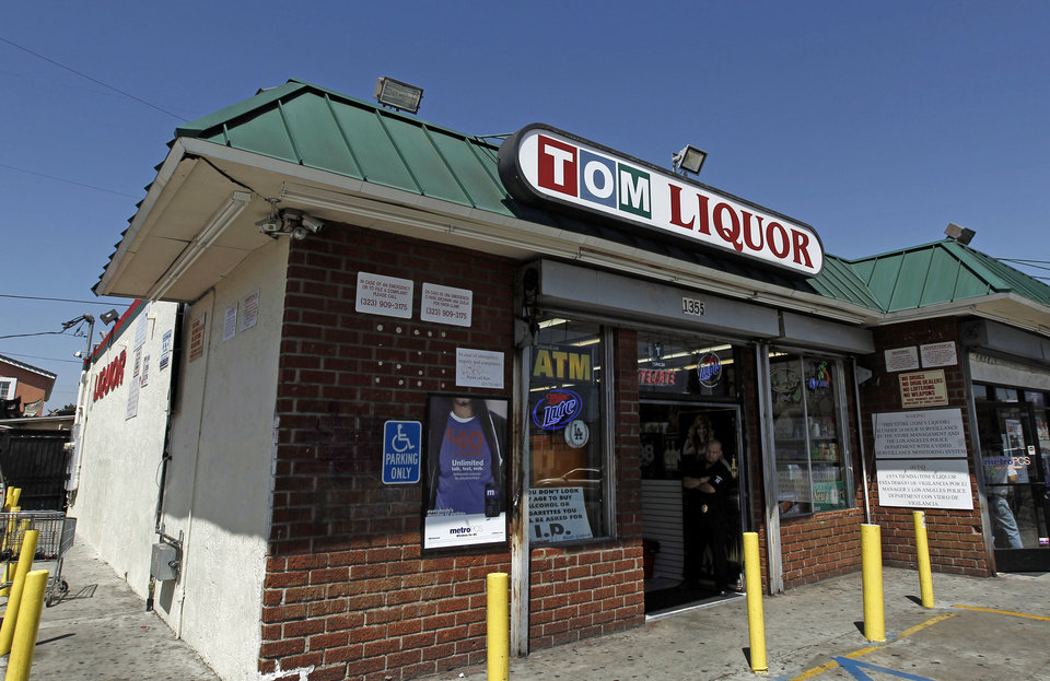 Photo -   This April 20, 2012 photo shows Tom's Liquor at the corner of Florence and Normandie in Los Angeles. Twenty years since the 1992 LA riots residents of the city's largely black and Hispanic South Side complain that the area still is plagued by too few jobs, too few grocery stores and a lack of redevelopment that would bring more life to the area. (AP Photo/Matt Sayles)