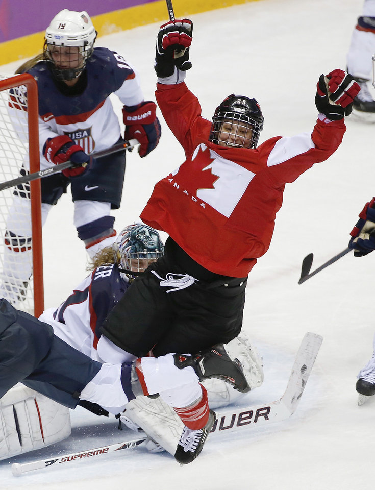 Photo - Marie-Philip Poulin of Canada, right, celebrates her goal against the United States in the third period of the women's gold medal ice hockey game at the 2014 Winter Olympics, Thursday, Feb. 20, 2014, in Sochi, Russia. (AP Photo/Petr David Josek, File)