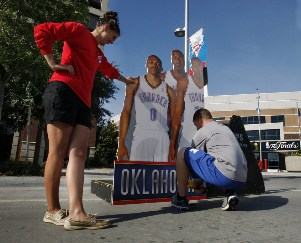 Alison Stier and Philip Roscoe set up materials for Thunder Alley on Reno Street in preparation for the first game of the NBA basketball finals at the Chesapeake Arena on Tuesday, June 12, 2012 in Oklahoma City, Okla. Photo by Steve Sisney, The Oklahoman