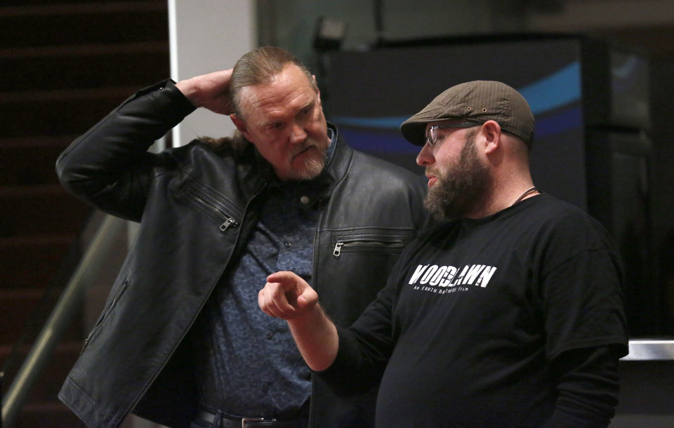 Photo - Co-director Andrew Erwin and actor Trace Adkins talk before a scene on the set of I can Only Imagine at the Oklahoma City Civic Center. [Photo by Sarah Phipps, The Oklahoman]