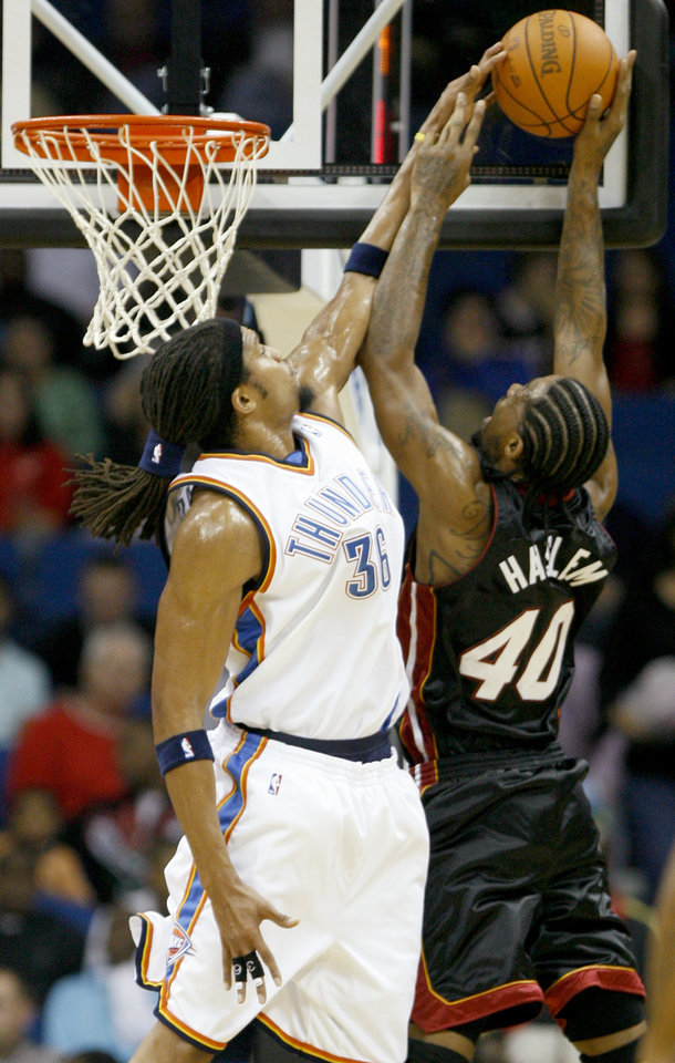 Oklahoma City's Etan Thomas blocks the shot of Miami's Udonis Haslem during an NBA preseason game between the Oklahoma City Thunder and the Miami Heat at the BOK Center in Tulsa, Okla., Wednesday, October 14, 2009. Photo by Bryan Terry, The Oklahoman