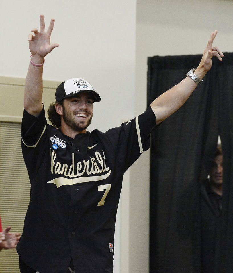 Photo - Vanderbilt second baseman Dansby Swanson is introduced during a victory celebration for the team's first baseball NCAA College World Series national championship at Vanderbilt University on Thursday, June 26, 2014, in Nashville, Tenn.  (AP Photo/Mark Zaleski)