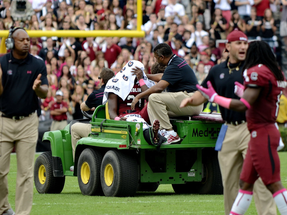 Photo -   South Carolina running back Marcus Lattimore is taken off the field in a cart after getting injured during the first half of an NCAA college football game against Tennessee, Saturday, Oct. 27, 2012 at Williams-Brice Stadium in Columbia, S.C. (AP Photo/Richard Shiro)