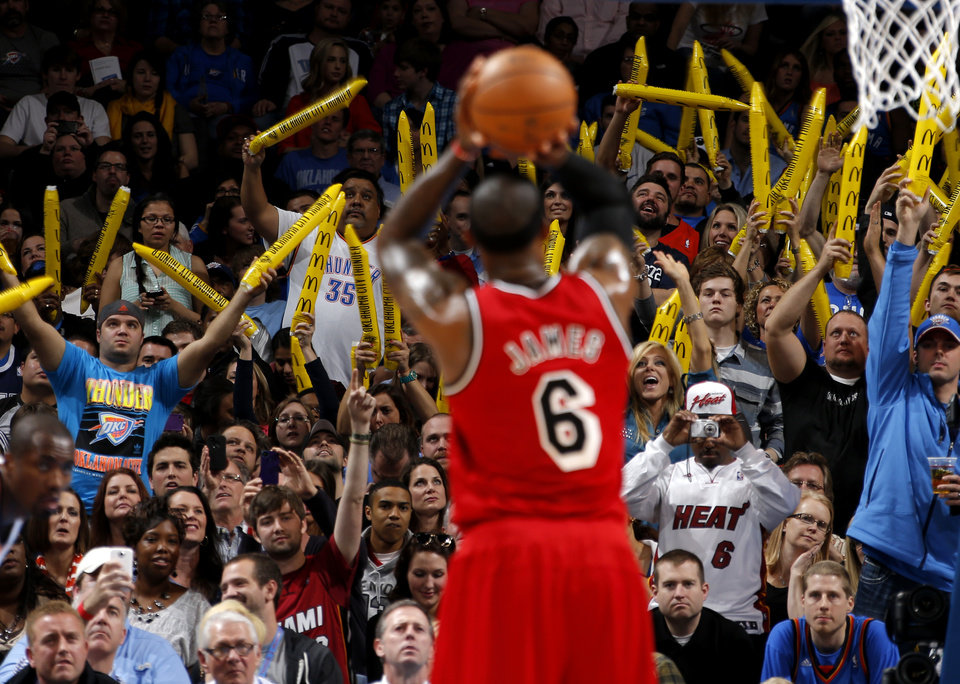 Fans cheer as Miami\'s LeBron James (6) shoots a free throw during an NBA basketball game between the Oklahoma City Thunder and the Miami Heat at Chesapeake Energy Arena in Oklahoma City, Thursday, Feb. 15, 2013. Photo by Bryan Terry, The Oklahoman