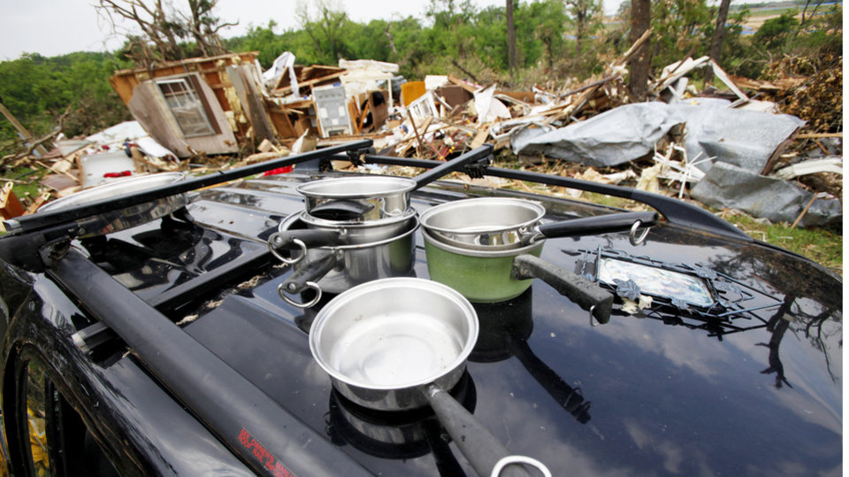 Above: Kitchen pots are among the thousands of pieces of debris a tornado scattered across Steve Johnson's property on Cedar Road in Harrah.