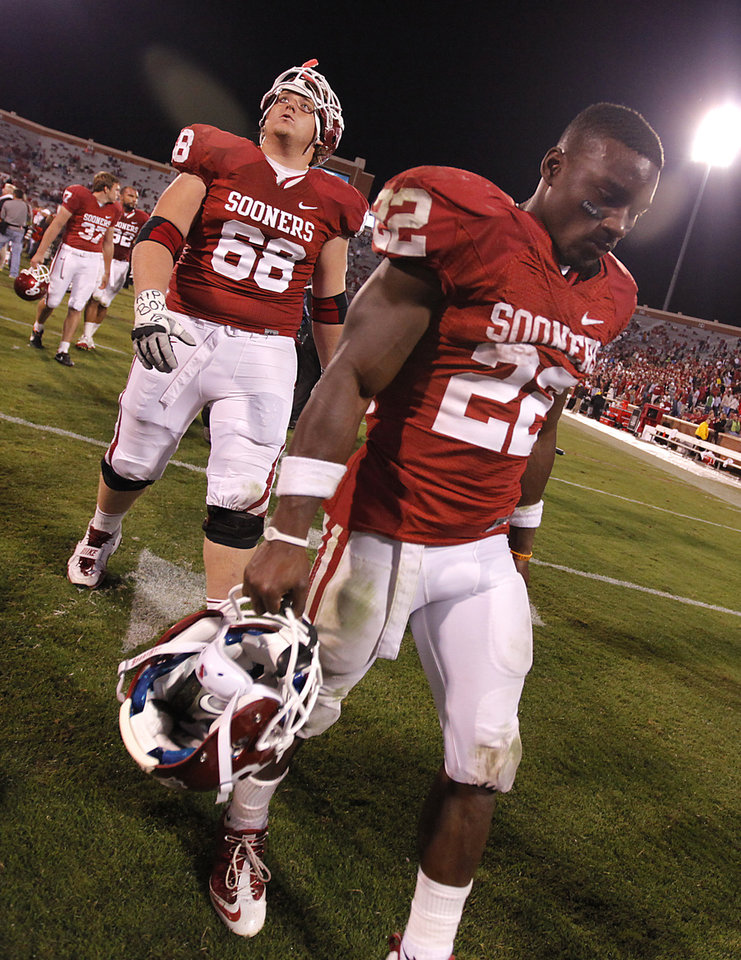Oklahoma's Roy Finch (22) and Bronson Irwin (68) walk off the field after the 41-38 loss to Texas Tech during the college football game between the University of Oklahoma Sooners (OU) and Texas Tech University Red Raiders (TTU) at the Gaylord Family-Oklahoma Memorial Stadium on Sunday, Oct. 23, 2011. in Norman, Okla. Photo by Chris Landsberger, The Oklahoman