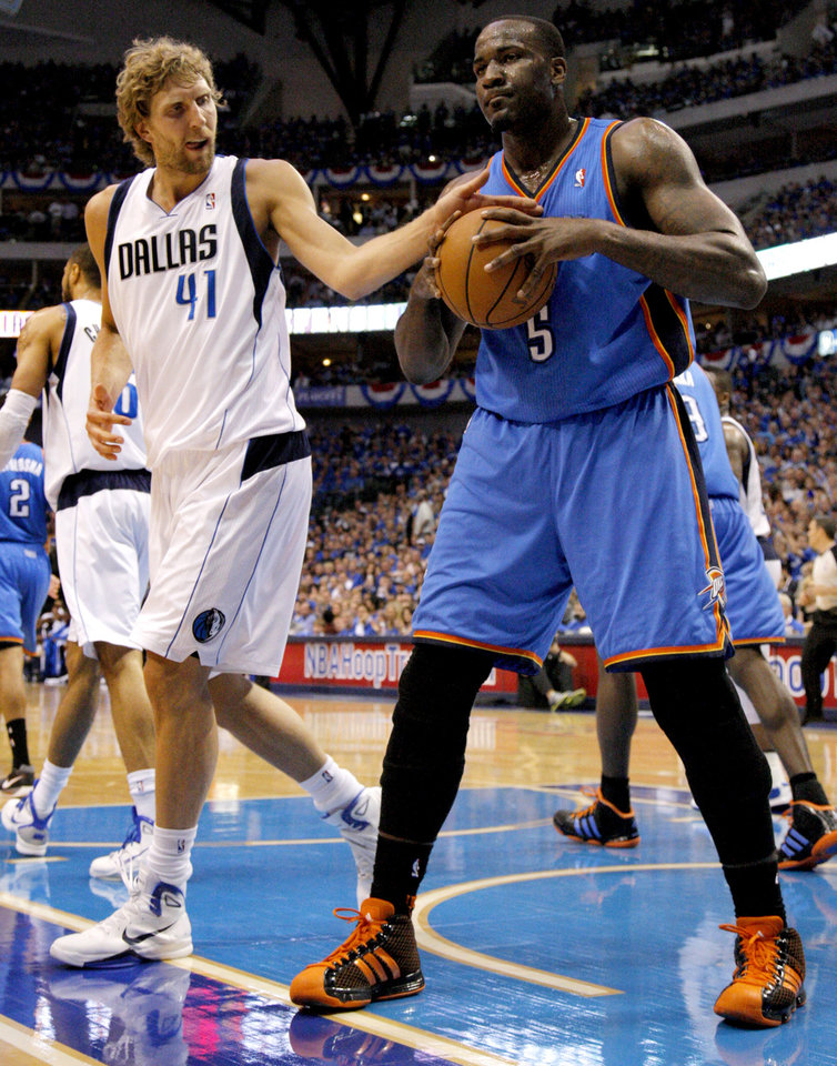 Photo - Dirk Nowitzki (41) of Dallas  tries to knock the ball away from Oklahoma City's Kendrick Perkins (5) after a foul during game 5 of the Western Conference Finals in the NBA basketball playoffs between the Dallas Mavericks and the Oklahoma City Thunder at American Airlines Center in Dallas, Wednesday, May 25, 2011. Photo by Bryan Terry, The Oklahoman