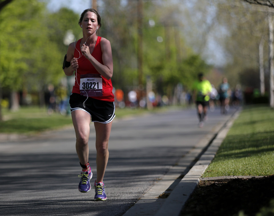 A runner travels south on Shartel just past mile 24 in  Heritage Hills during the Oklahoma City Memorial Marathon in Oklahoma City, Sunday, April 28, 2013.  Photo by Garett Fisbeck, For The Oklahoman