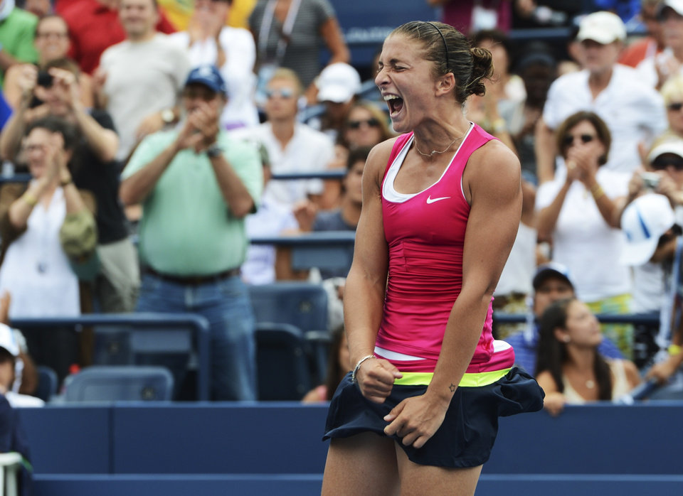 Photo -   Italy's Sara Errani returns a shot to Germany's Angelique Kerber in the fourth round of play at the 2012 US Open tennis tournament, Monday, Sept. 3, 2012, in New York. Errani won the match. (AP Photo/Henny Ray Abrams)