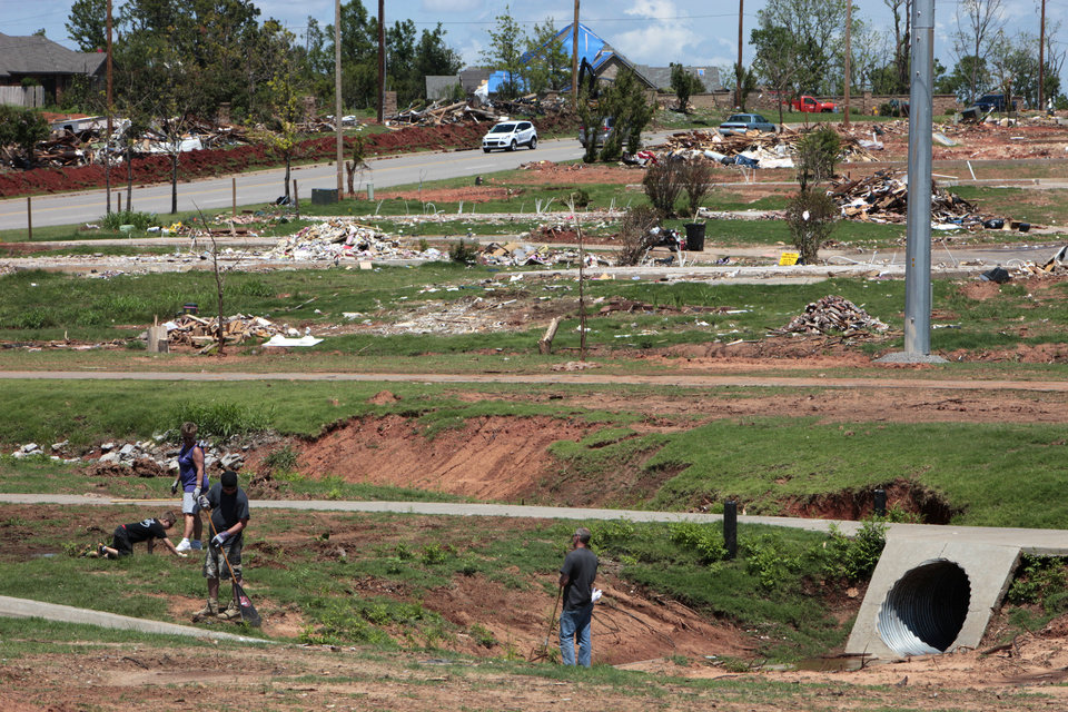 Photo - Clean up continues weeks after EF5 tornado hit Moore.   David McDaniel - The Oklahoman