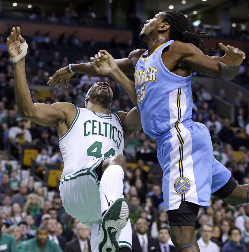 Boston Celtics power forward Chris Wilcox (44) goes down after a shot-attempt against the defense of Denver Nuggets forward Kenneth Faried (35) during the first half of an NBA basketball game in Boston, Sunday, Feb. 10, 2013. (AP Photo/Elise Amendola)