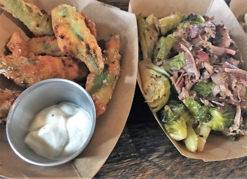 Photo - Fried okra, left, and Burnt Ends Brussels sprouts from The Smoking Boar. [Dave Cathey/The Oklahoman]