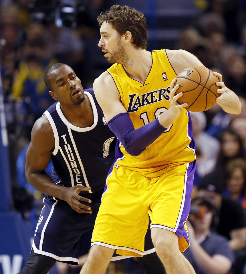 Photo - Oklahoma City's Serge Ibaka (9) defends LA's Pau Gasol (16) during an NBA basketball game between the Los Angeles Lakers and the Oklahoma City Thunder at Chesapeake Energy Arena in Oklahoma City, Friday, Dec. 13, 2013. Photo by Nate Billings, The Oklahoman