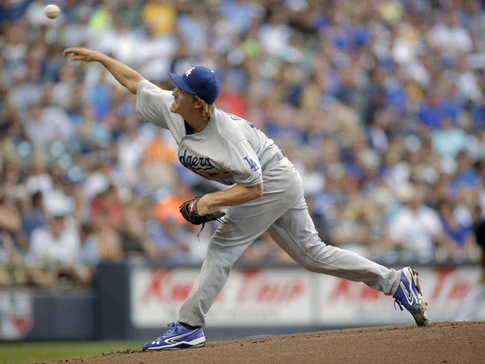 Photo - Los Angeles Dodgers pitcher Zack Greinke pitches to the Milwaukee Brewers during the first inning of a baseball game Saturday, Aug. 9, 2014, in Milwaukee. (AP Photo/Darren Hauck)