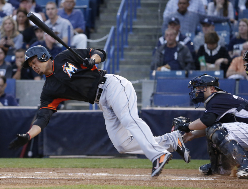 Photo - Miami Marlins' Giancarlo Stanton loses his footing and falls to the dirt in the first inning of a spring exhibition baseball game against the New York Yankees in Tampa, Fla., Friday, March 28, 2014. The Yankees defeated the Marlins 3-0. (AP Photo/Kathy Willens)