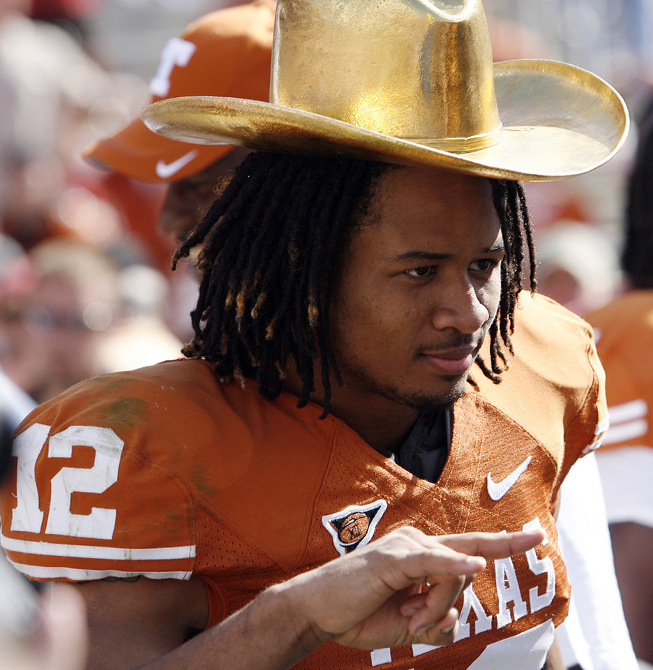 Photo - Texas' Earl Thomas (12) wears the Golden Hat Trophy after the Longhorn's 16-13 win over Oklahoma during the Red River Rivalry college football game between the University of Oklahoma Sooners (OU) and the University of Texas Longhorns (UT) at the Cotton Bowl in Dallas, Texas, Saturday, Oct. 17, 2009. Photo by Chris Landsberger, The Oklahoman