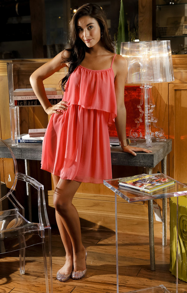 Photo - Clear fashion accessories from Dillard's, Penn Square Mall; shoes from Balliets. Dress, acrylic chair, lamp, table and bookshelf from Cayman's. Model Kimber's makeup by Elizabeth Farris, Cayman's. Photo by Chris Landsberger, The Oklahoman  CHRIS LANDSBERGER