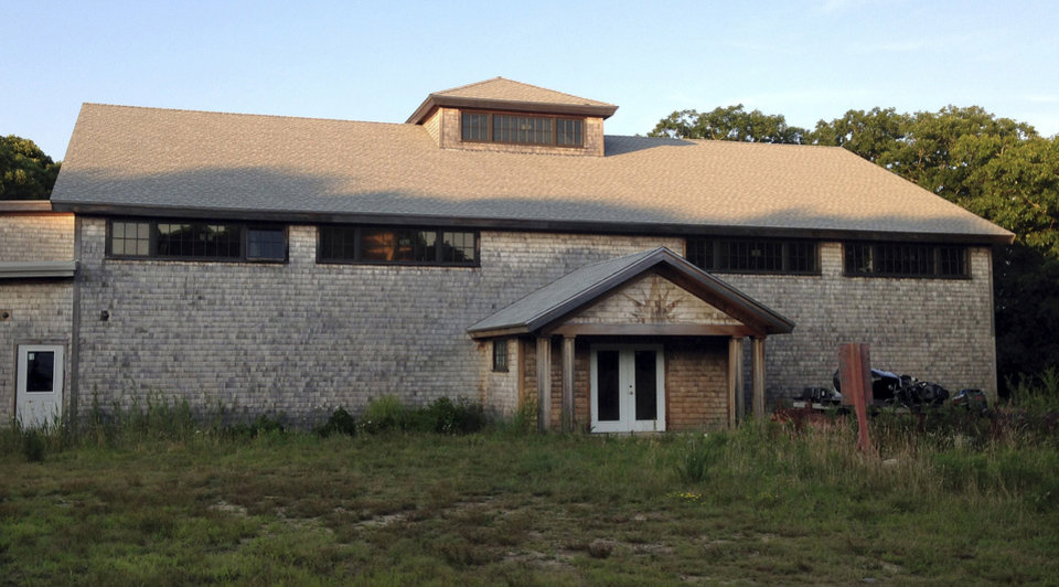 Photo - FILE - In this Monday, Aug. 4, 2014, file photo, the unfinished community center sits on the Aquinnah Wampanoag reservation in Aquinnah, Mass., on the island of Martha's Vineyard. The tribe proposes turning the building into a high-stakes bingo and poker hall filled with electronic betting machines to help provide economic self-sufficiency for its some 1,200 members. Gov. Deval Patrick has sued in federal court to block the project. (AP Photo/Phil Marcelo, File)
