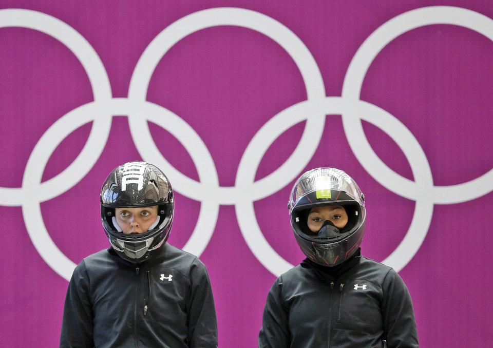 Photo - Members of the team from the United States USA-3, Jazmine Fenlator, right, and Lolo Jones, prepare for their start during the women's bobsleigh training at the 2014 Winter Olympics, Saturday, Feb. 15, 2014, in Krasnaya Polyana, Russia. (AP Photo/Dita Alangkara)