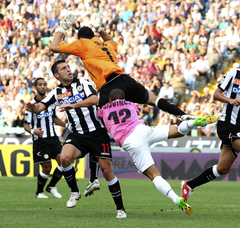 Photo -   Udinese goalkeeper Zeljko Brkic, top, of Serbia, jumps for the ball with Juventus' Mirko Vucinic of Montenegro, right, during a Serie A soccer match between Udinese and Juventus at the Friuli Stadium in Udine, Italy, Sunday, Sept. 2, 2012. (AP Photo/Paolo Giovannini)