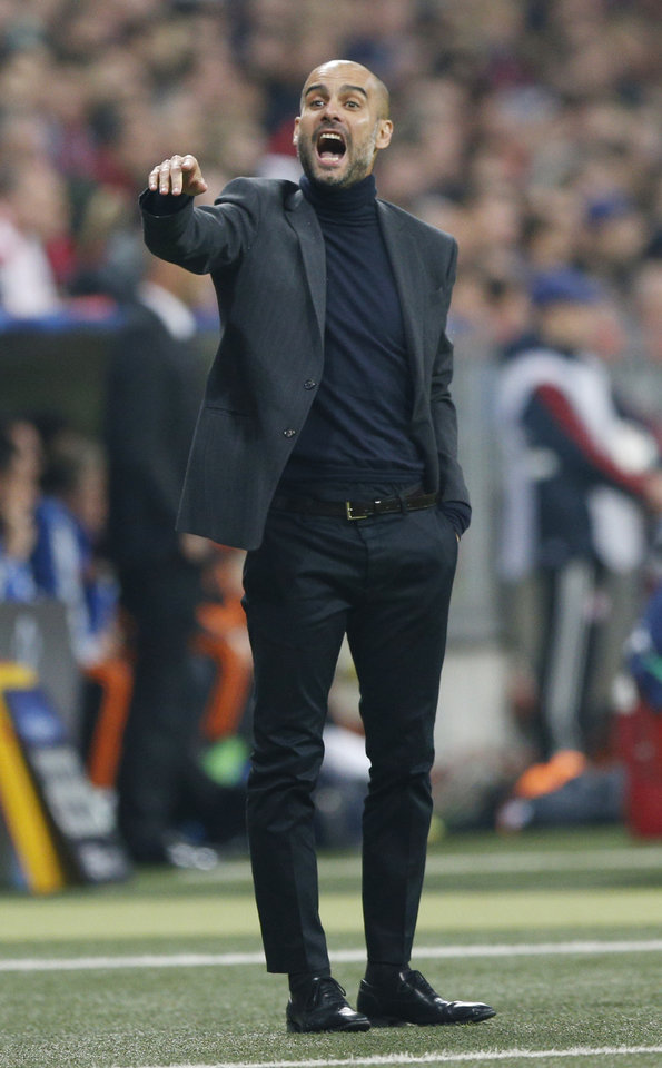 Photo - Bayern head coach Pep Guardiola gestures during the Champions League semifinal second leg soccer match between Bayern Munich and Real Madrid at the Allianz Arena in Munich, southern Germany, Tuesday, April 29, 2014. (AP Photo/Matthias Schrader)