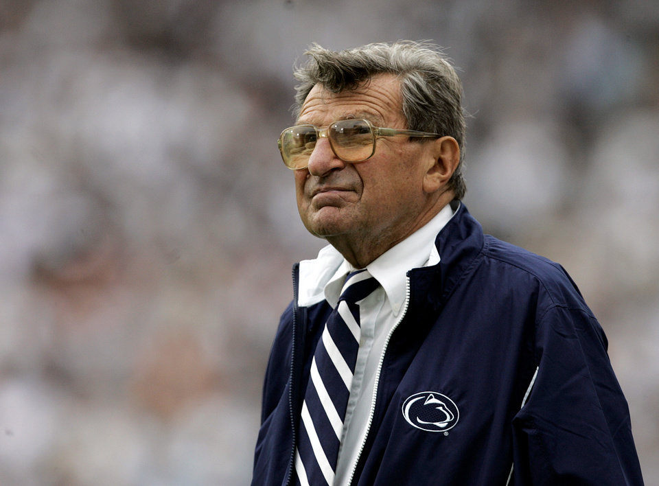 Photo -   FILE- In this Sept. 16, 2006 photo, Penn State coach Joe Paterno watches the college football game against Youngstown State from the side lines in State College, Pa. When Penn State opens its football season on Saturday, Sept. 1, 2012, for the first time since 1965, no one with the last name of Paterno will be on the sidelines. Paterno died of cancer in January 2012, just months after losing his job in the wake of the Jerry Sandusky sex abuse scandal. (AP Photo/Carolyn Kaster, File)