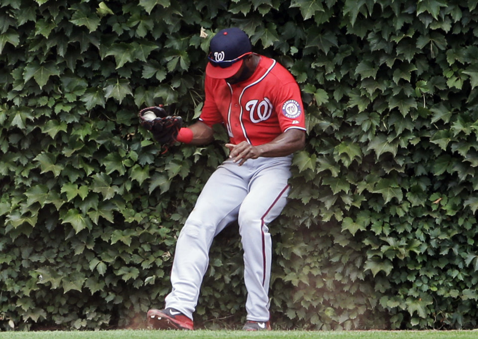 Photo - Washington Nationals center fielder Denard Span catches a fly ball hit  during the fourth inning of a baseball game in Chicago, Saturday, June 28, 2014.  (AP Photo/Nam Y. Huh)