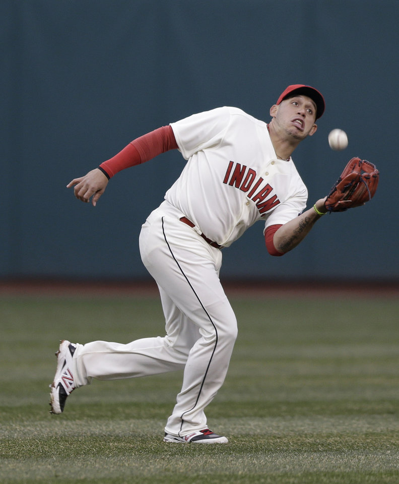 Photo - Cleveland Indians' Asdrubal Cabrera catches a fly ball hit by Minnesota Twins' Aaron Hicks during the fourth inning of a baseball game, Friday, April 4, 2014, in Cleveland. (AP Photo/Tony Dejak)