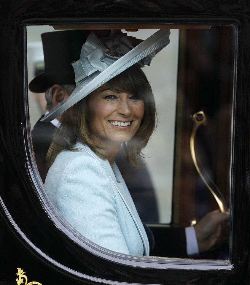 Photo - Carole Middleton, Kate Middleton's mother, leaves Westminster Abbey at the Royal Wedding in London Friday, April 29, 2011. (AP Photo/Alastair Grant)  ORG XMIT: RWFO160