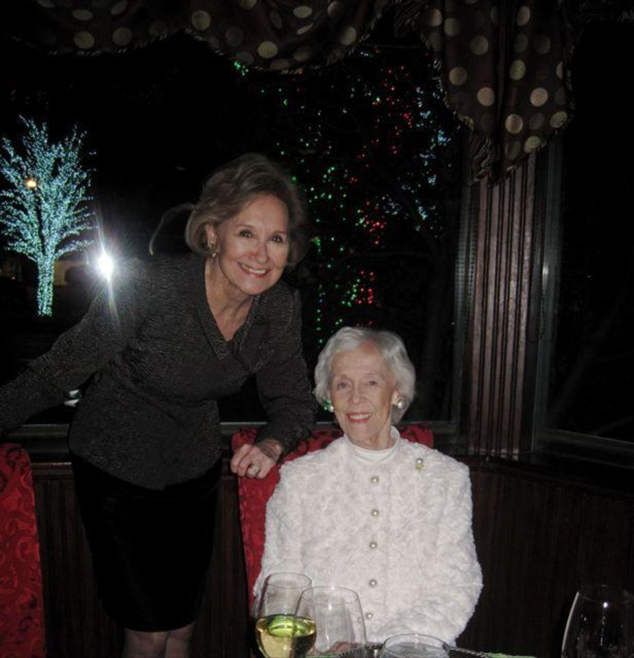 SPARKLE AND SHIMMER...Kaye Cook and Marylin Upsher talk at the party at The Coach House where lights in the trees in the shopping area at Nichols Hills Plaza surrounded the restaurant and provided a beautiful and colorful holiday setting. (Photo by Helen Ford Wallace).