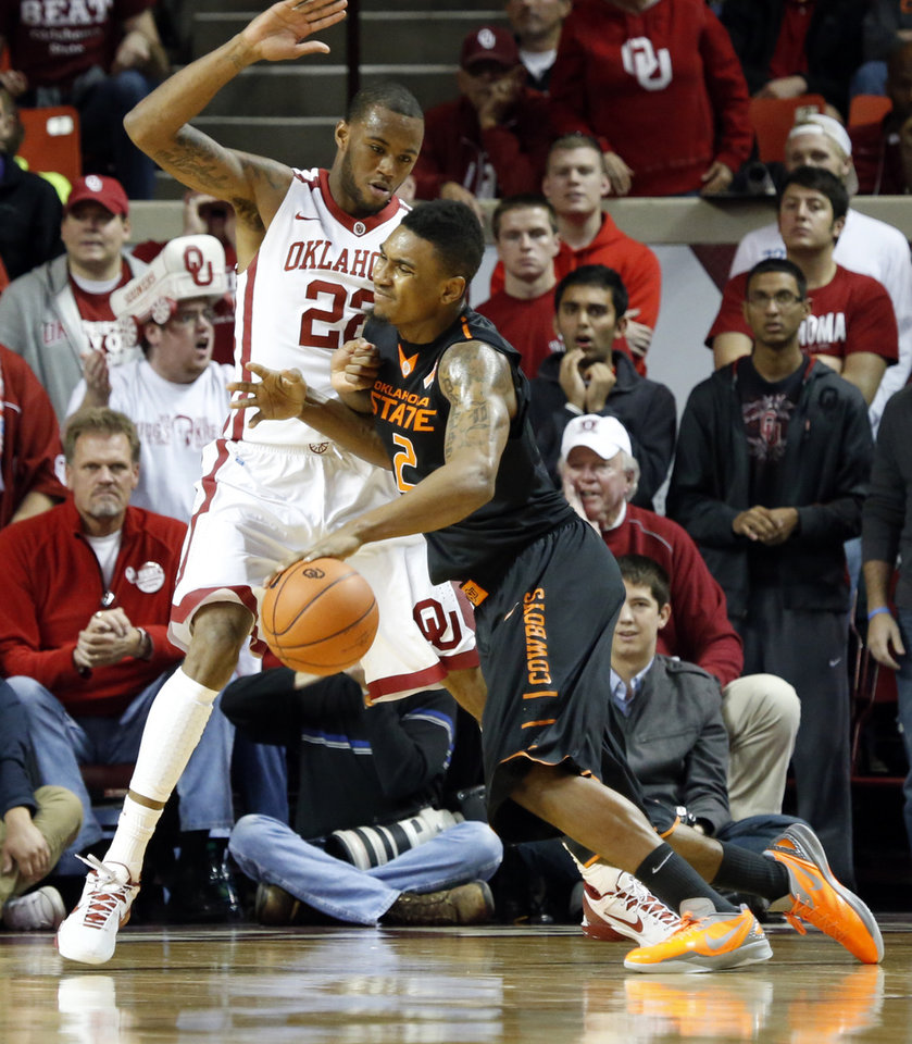 Photo - Cowboy's Le'Bryan Nash (2) tries to drive around Sooner's Amath M'Baye (22) during the second half as the University of Oklahoma Sooners (OU) defeat  the Oklahoma State Cowboys (OSU) 77-68  in NCAA, men's college basketball at The Lloyd Noble Center on Saturday, Jan. 12, 2013  in Norman, Okla. Photo by Steve Sisney, The Oklahoman