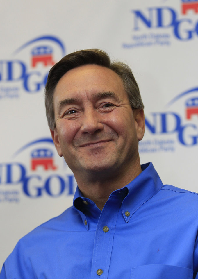 Republican U.S. Senate candidate Rick Berg smiles at the NDGOP Victory Office during a campaign stop in Grand Forks, N.D, Sunday, Nov. 4, 2012. Berg is running against Democrat Heidi Heitkamp for North Dakota's U.S Senate seat. (AP Photo/LM Otero)