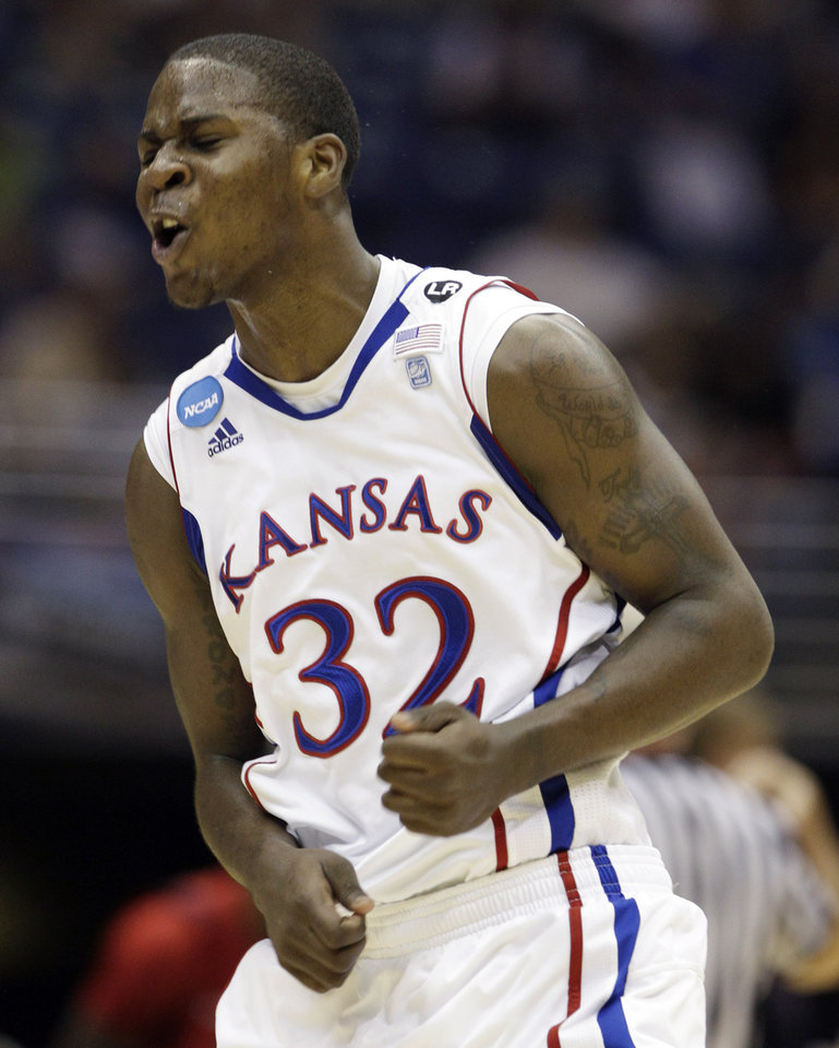 Kansas' Josh Selby reacts against Richmond during the first half of a Southwest regional semifinal game in the NCAA college basketball tournament Friday, March 25, 2011, in San Antonio.  (AP Photo/Tony Gutierrez)