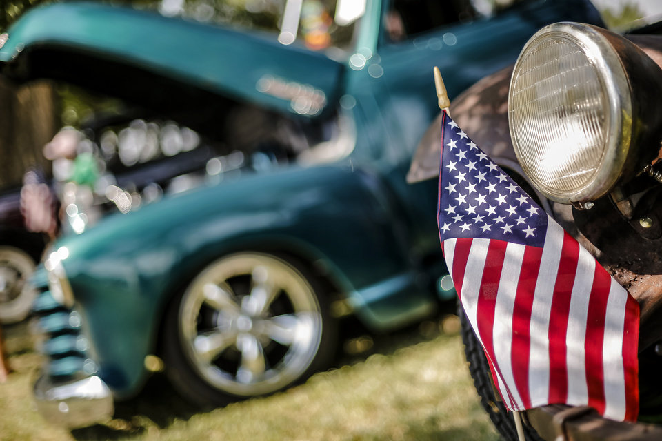 An American Flag is displayed on the front of a car in the car show during the Yukon Freedom Fest at the Yukon City Park on Thursday , July 4, 2013, in Yukon, Okla. Photo by Chris Landsberger, The Oklahoman